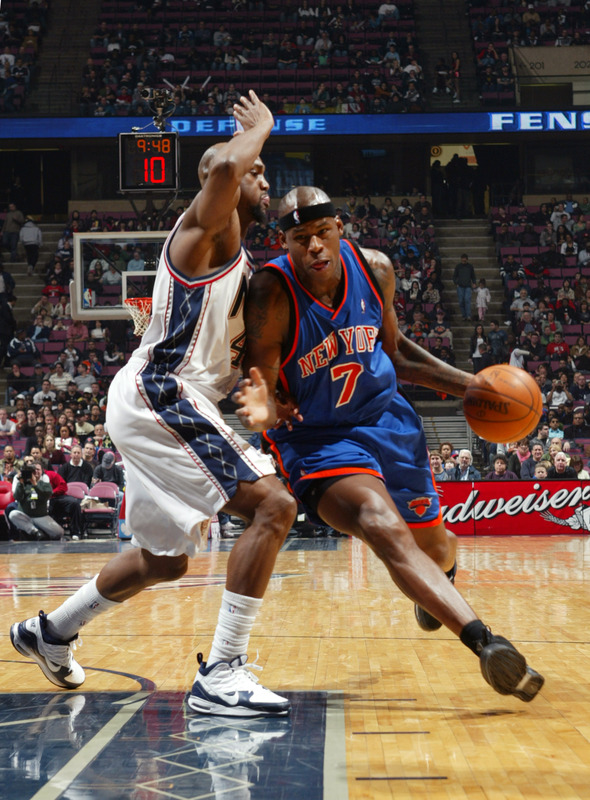 Al Harrington (7) of the New York Knicks drives the lane  against Trenton Hassel (44) of the New Jersey Nets on November 21, 2009 at the Izod Center in East Rutherford, New Jersey.   The  New York  Knicks  would   go  on to  defeat  the New Jersey  Nets  98-91  .    picture appears courtesy of NBAE/Getty Images/  Jeyhoun  Allebaugh  ............