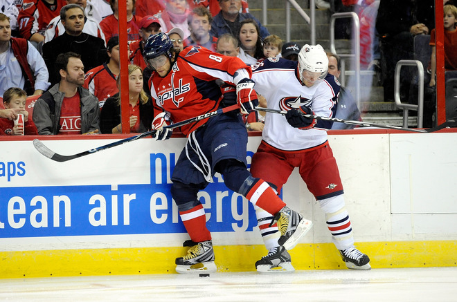 Alexander  Ovechkin (#8) of the  Washington  Capitals  often  described  as  the  best player  in the  NHL battles  for  the  puck  against  the  Columbus Blue Jackets'  Jason Chimer  (#25) in  game   played the  Verizon  Center  in  Washington  DC.    picture  appears courtesy  of   getty images/ Greg  Fiume  ..............