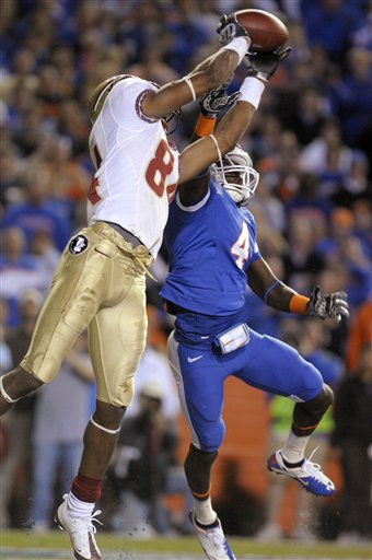 Florida cornerback Wondy Pierre-Louis, right, breaks up a pass intended for Florida State receiver Rodney Smith in the end zone during the second half of an NCAA college football game in Gainesville, Fla., Saturday, Nov. 28, 2009. picture  appears   courtesy by  AP/Photo/ Phelan M  Ebenhack  ...........