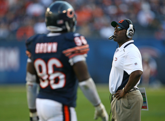 Bears' coach  Lovie Smith  watches as  his  defensive players  leave the  field late in the  game  against  the  Arizona  Cardinals.   picture appears courtesy  of getty images/ Johnathan Daniel .............