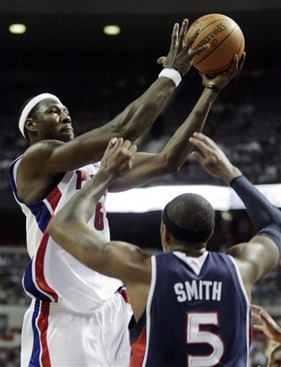Detroit Pistons center Ben Wallace (6) takes a shot over Atlanta Hawks forward Josh Smith (5) in the second half of an NBA basketball game Sunday, Nov. 29, 2009, in Auburn Hills, Mich. Wallace scored 10 points and pulled down 18 rebounds in the Pistons' 94-88 win. picture appears courtesy of  AP/photo/ Duane Burleson  ..............