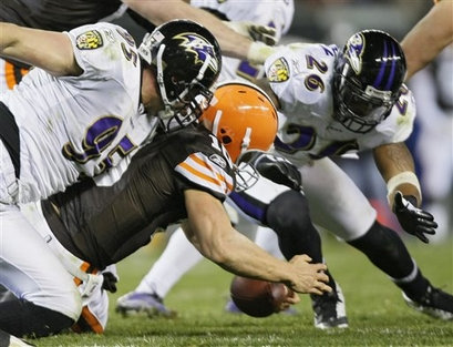 Cleveland Browns quarterback Brady Quinn recovers his own fumble as Baltimore Ravens linebacker Jarret Johnson (95) and safety Dawan Landry (26) converge in the fourth quarter of an NFL football game Monday, Nov. 16, 2009, in Cleveland. The Browns lost 16-0.       picture appears courtesy  ap/photo/ Mark  Duncan  .............