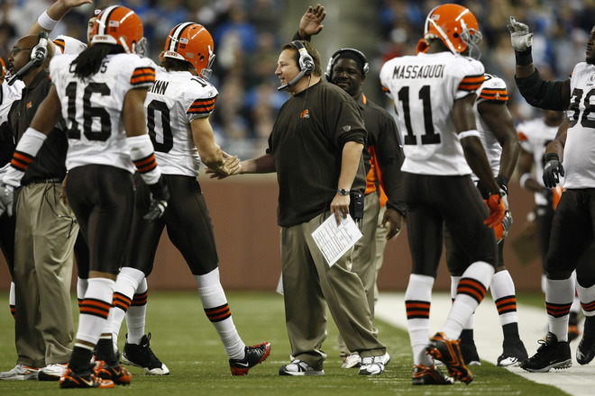 Head coach Eric Mangini of the Cleveland Browns congratulates quarterback, Brady Quinn (10) after a touchdown pass against the Detroit Lions at Ford Field on November 22, 2009 in Detroit, Michigan. The Lions came from behind to defeat the Browns 38-37. picture appears  courtesy of getty images/ Joe Robbins  ..............
