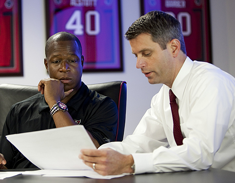 Tampa Bay Buccaneers Head Coach Raheem Morris and General Manager Mark Dominik discuss the Buccaneers first round selection in the draft room at One Buccaneer Place on Saturday, April 25, 2009, in Tampa, Florida. Photo by Matt May/Tampa Bay Buccaneers