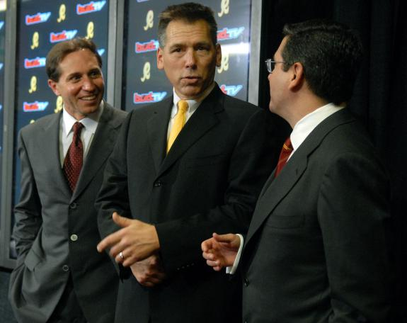 From left to  right  ,  Vinny Cerrato  , Exec VP & General Manger  of the  Redskins   alongside  the  newly minted  team  coach   Jim Zorn and  finally  team  owner  Daniel Snyder.    The  three were  at  the  team's  training  facility  in Ashburn  , Virgina ,  to  make the  formal   announcement  to the  convened  press  that  Zorn  had  been hired as  the  head  coach  of  the  Washington Redskins.  This was  made  effective  10th February  2008.  picture appears courtesy of   upi photo/  Kevin  Dietsch  ..........