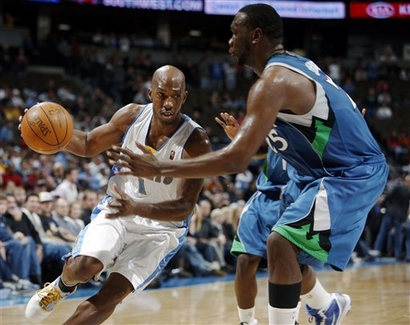 Denver Nuggets guard Chauncey Billups, left, drives for the basket as Minnesota Timberwolves center Al Jefferson defends in the fourth quarter of the Timberwolves' 106-100 victory in an NBA basketball game in Denver on Sunday, Nov. 29, 2009. The victory broke Minnesota's 15-game losing streak. picture  appears courtesy of  AP/photo/David Zalubowski ............