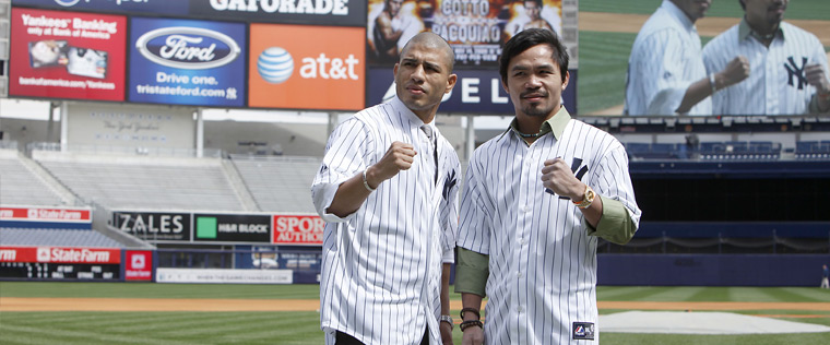 Cotto and  Pacquiao  pose  for the   press on the  hallowed  ground  of  Yankees  Stadium  in New York  City, New  York.   picture appears courtesy  of   ap/photo/Will Hart ................