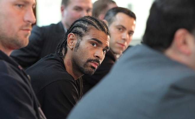 The newly  crowned WBA heavyweight  champion of the  world  David  Haye (center  foreground) who won  the  title  with a  unanimous  decision over the  former  champion  , Nikolai Valuev of  Russia .     picture  appears  courtesy  of afp/getty images/  Shaun  Curry ............