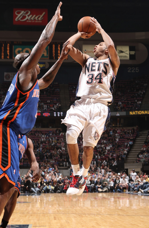 Devin Harris (34) of the New Jersey Nets shoots against Al Harrington (7) of the New York Knicks on November 21, 2009 at the Izod Center in East Rutherford, New Jersey.   picture appears  courtesy of  NBAE/Getty Images/  Jeyhoun  Allebaugh ..............