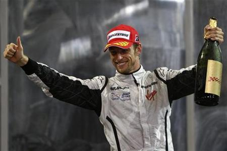 Formula 1 World  Champion  Jenson Button  celebrates  his  third  place  finish    at the  Abu  Dhabi  Grand  Prix  as the  Yas  Marina  Circuit  in Abu  Dhabi     .       Button   is   a  first  time  winner  of  the  world championship   and  has become  the  second  consecutive  British   driver  to win  the  championship  in the  last  two  years.   He succeeds  Lewis   Hamilton  who  became  the  first  black  driver to  win  the   prestigious   title.       picture  appears   courtesy  of  reuters/  Steve  Crisp  .........
