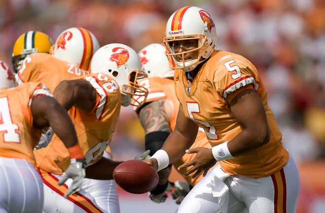Buccaneers quarterback  Josh   Freeman  hands the ball  off  during the   game  played  against  the  Green Bay  Packers at  Raymond  James Stadium  in  Tampa Florida .  The  Buccaneers   would   go  on to  defeat  Green  Bay  38-28  and  being  ensured    of  their   first  win  of the  season.   picture  apears  courtesy  of  getty  images/ J Meric .............