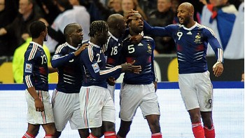 French teammates  celebrate  their  gaining  a  berth  in  next year's  World  Cup  having  just  entered  2-1 on  aggregate with their resultant  tie  with  Ireland.    picture  appears  courtesy  agence-provencale s.a/paris/   Paul   Hebert ...................
