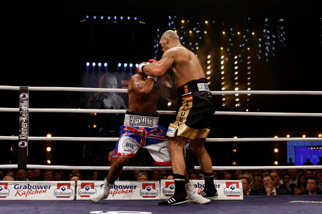 Haye  looks to evade  a  shot  from Valuev  while on the  ropes  during  their title  bout.  The  scene  of the  event  was  the   Nurumber  Verischerung  Arena  in  the  city  of  Nurumberg , Germany.      picture appears courtesy of  Bongarts/getty images/  Alex  Grimm  ..................