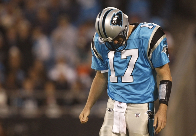 Jake Delhomme (17) of the Carolina Panthers stands on the field with his head down against the Miami Dolphins at Bank of America Stadium on November 19, 2009 in Charlotte, North Carolina.     picture appears courtesy of  getty images/  Streeter  Lekca  ...............