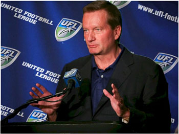 Jim Fassel   seen  here  addressing  the  media  as  to his  aspirations for  the New  York  based   UFL  franchise  .  The  New  York  Sentinels   took  to  formally to  life   after   Fassel's   introduction as  the  team's  new  head coach.       picture   appears   courtesy  of  ap/photo /  Paul   Howard  ...................