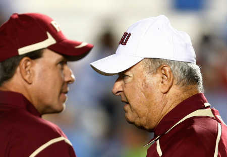 Coach Bowden,  seen  here on the  right  along with  his  offensive coordinator and  assistant  coach, Jimbo Fisher  working  the  sidelines  of a  game  against ACC rivals  North Carolina, in Chapel Hill ,  North Carolina.   A  game  the  Seminoles would  narrowly win  30-27 .      picture   appears   courtesy  getty images/  Ralph   Peterson  ....................