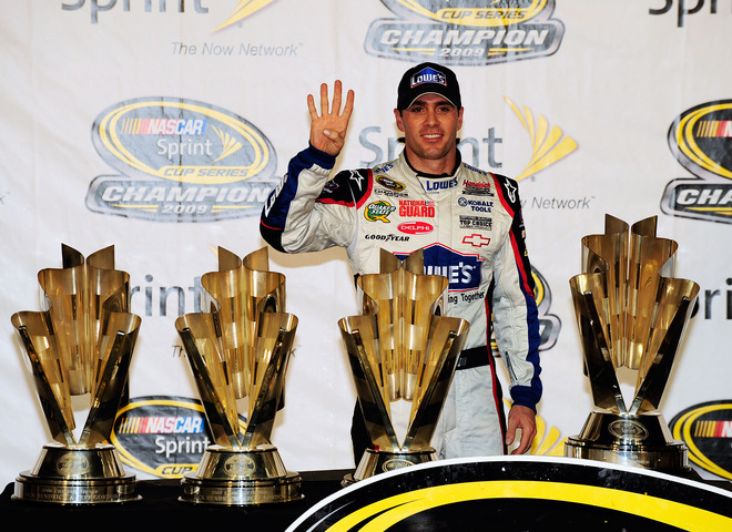 Homestead ,Fl ,.  Jimmie Johnson, driver of the (48) Lowe's Chevrolet, poses with all four of his championship trophies after winning the NASCAR Sprint Cup Series Championship at Homestead-Miami Speedway on November 22, 2009 in Homestead, Florida. Johnson becomes the first driver in the history of NASCAR to win four consecutive championships since the sports inception in 1949. picture appears courtesy of  Getty Images/ Sam Greenwood ....................