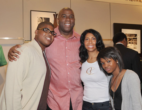 Johnson  seen  here  with  hjs   family  ,  his   wife  Cookie pictured next him   along   with    his   son  EJ , 17 and   daughter   Elisa 14.  Johnson  also  has an  older  son  Andre  aged   20.    picture appears  courtesy of  ap/photo/ Ross  Harrison  ..............