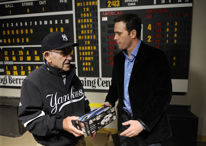 Little Falls , NJ -  Four-time Nascar champion Jimmie Johnson presents a model of his #48 Lowe's Chevrolet to  Baseball Hall of Famer Yogi Berra at a tour of the Yogi Berra Museum and and Learning Center on November 23, 2009 in Little Falls, New Jersey.  picture appears  courtesy of Getty Images/ Jeff  Zelevansky  .....................