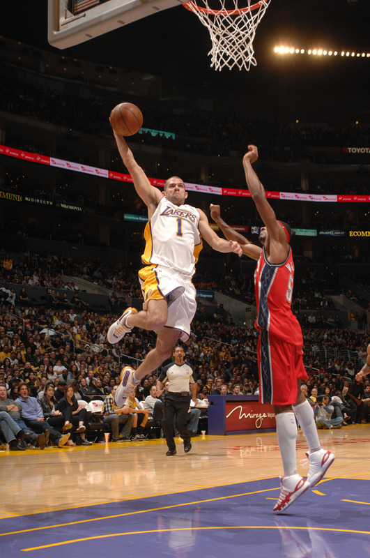 Los Angeles , California , November 29th,. Jordan Farmar (1) of the Los Angeles Lakers goes up for a shot against the New Jersey Nets at Staples Center on November 29, 2009 in Los Angeles, California.  picture appears  courtesy  of NBAE/Getty Images/ Noah Graham ..........