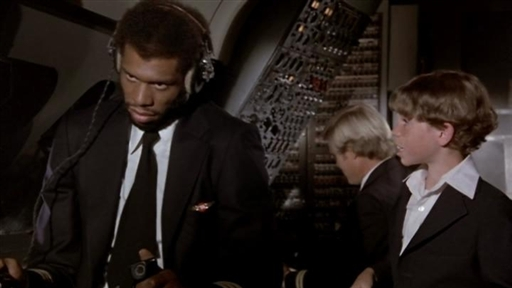 Kareem   in  a  memorable scene  from the  movie  Airplane  . A monumental  hit at the  box  office  that would  provide  Kareem  with  other  roles along  the way.