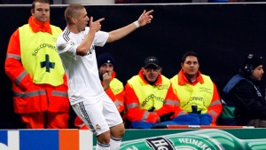 Karim Benzema of Real Madrid celebrates after scoring during the UEFA Champions League Group C match between Real Madrid and Milan at San Siro on November 3, 2009 in Milan, Italy. picture appears courtesy getty images-italia   /    David  R  Anchuelo  ................