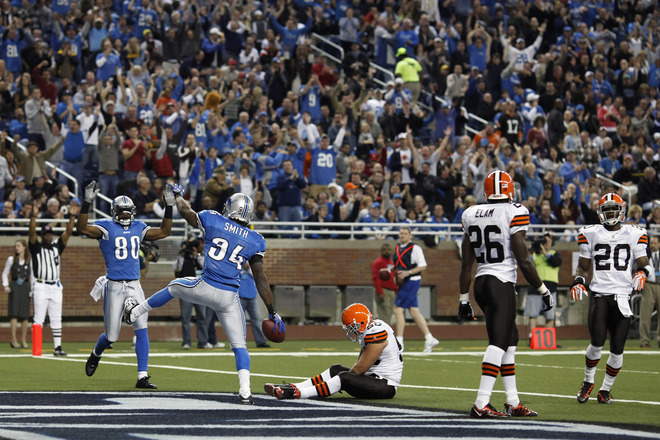 Kevin Smith (34) of the Detroit Lions celebrates after catching a touchdown pass against the Cleveland Browns at Ford Field on November 22, 2009 in Detroit, Michigan. The Lions came from behind to defeat the Browns 38-37.  picture appears courtesy of getty images/  Joe  Robbins .............