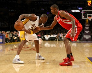 Kobe Bryant of the Los Angeles Lakers controls the ball against Trevor Ariza  of the Houston Rockets on November 15, 2009 at Staples Center in Los Angeles, California.  The Rockets won 101-91.    picture appears courtesy  of  getty  images/ Stephen  Dunn