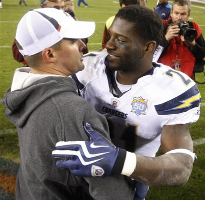San Diego Chargers' LaDainian Tomlinson, right, chats with Denver Broncos head coach Josh McDaniels after an NFL football game, Sunday, Nov. 22, 2009, in Denver. The Chargers defeated the Broncos 32-3.  picture appears courtesy of  AP photo / Jack Dempsey   .............