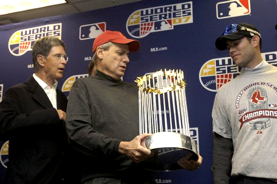 Larry Lucchino  (center)  and  Theo  Epstein,  (right) seen here  with   principal partner  and  owner   John  Henry  of  the  Boston  Red  Sox.  picture  appears  courtesy  of  AP/photo/  Chris Argyle  ...................