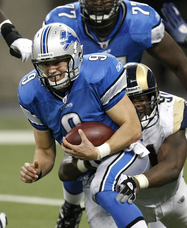 Lions'  quarterback   Matthew  Stafford  is  tackled  by  the  St Louis Rams'  Leonard  Little  in  an NFL game  played  at   Ford  Field  in  Detroit  , Michigan ,.   picture  appears courtesy of  getty images/  Gregory  Shamus  ................