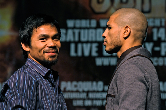 Boxer Manny Pacquiao (L) smiles as he poses with WBO welterweight champion Miguel Cotto during the final news conference for their bout at the MGM Grand Hotel/Casino November 11, 2009 in Las Vegas, Nevada. Pacquiao and Cotto will meet in a WBO welterweight title fight at the MGM Grand on November 14.  (Photo by Ethan Miller/Getty Images)