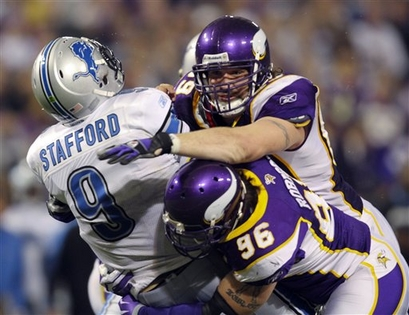 Detroit Lions quarterback Matthew Stafford (9) gets roughed up by Minnesota Vikings' Jared Allen (69) and Brian Robison (96) after throwing an incomplete pass in the third quarter of an NFL football game Sunday, Nov. 15, 2009, in Minneapolis.    picture appears courtesy of  ap/photo/ Star Tribune/  Jeff Wheeler  ....................