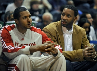 Houston Rockets forward Tracy McGrady, right, speaks with Rockets forward Brian Cook on the bench as they play the Atlanta Hawks during the second quarter of an NBA basketball game at Philips Arena, Friday, Nov. 20, 2009, in Atlanta. The Hawks went on to win 105-103. The Rockets believe McGrady needs more time and would risk hurting his knee again if he comes back too soon.    picture appears  courtesy  of  ap/photo/ Gregory  Smith  ..................