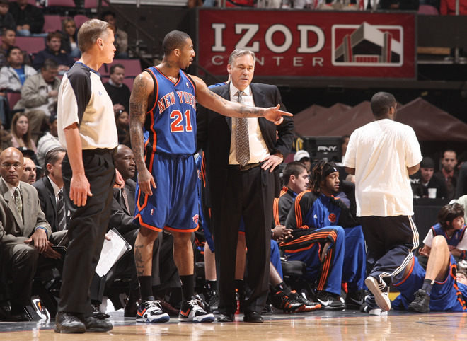 East Rutherford , NJ - NOVEMBER 21: Mike D'Antoni speaks with Wilson Chandler (21) of the New York Knicks during a game against the New Jersey Nets on November 21, 2009 at the Izod Center in East Rutherford, New Jersey.   picture appears  courtesy  of NBAE/Getty Images/ Jeyhoun  Allebaugh   ......................