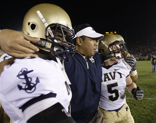 Navy head coach Ken Niumatalolo, middle, is congratulated by safety Jarred Shannon (10), left, and running back John Howell (5) after Navy defeated Notre Dame in an NCAA college football game in South Bend, Ind., Saturday, Nov. 7, 2009.   picture appears  courtesy  of  ap/photo/ Darron Cummings ................