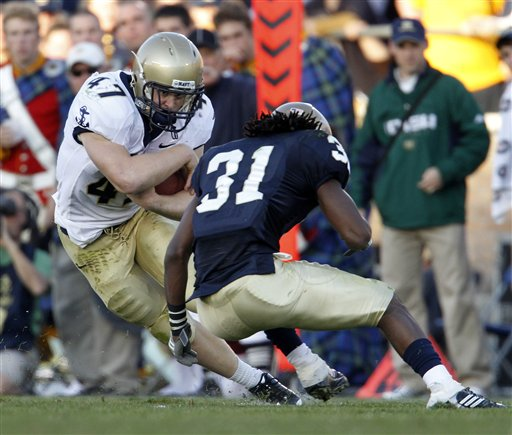 Navy fullback Vince Murray (47) runs against  Notre Dame safety Sergio Brown during the third quarter of an NCAA college football game in South Bend, Ind., Saturday, Nov. 7, 2009. (AP Photo/Darron Cummings)