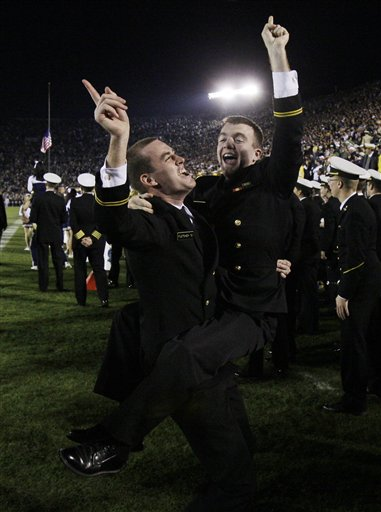 Navy  midshipmen  celebrate the  team's  upset victory of  Notre Dame 23-21 in   game played in South Bend , Ind,.  picuture  appears  courtesy of   ap/photo/ Darron  Cummings  ............