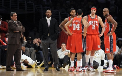 New Jersey Nets team members from left, interim coach Tom Barrise, assitant coach Doug Overton, Chris Douglas-Roberts, Devin Harris, Josh Boone and Trenton Hassell look on during the second half of their NBA basketball game against the Los Angeles Lakers, Sunday, Nov. 29, 2009, in Los Angeles. The Nets matched the worst start to an NBA season with their 17th straight loss Sunday night in the Lakers' 106-87 victory.picture appears  courtesy  of AP/Photo/Mark J. Terrill ..........