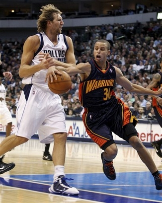 Dallas Mavericks forward Dirk Nowitzki (41), of Germany, loses the ball to Golden State Warriors guard Stephen Curry (30) during the second half of an NBA basketball game Tuesday, Nov. 24, 2009, in Dallas. The Warriors won 111-103. picture appears courtesy of AP/Photo/ Sharon Ellman  ...........