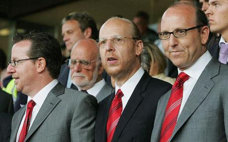 Patriarch  Malcolm  Glaze (center)  and   two of his  sons Joel  (right) and  Brian  , far  left  , seen here  attending   a  Premiership  league  game   at Old  Trafford ,   Manchester  United's  home   venue .   picture appears  courtesy  of    dailytelegraph.uk.co/ Anthony  Hodgins  .................