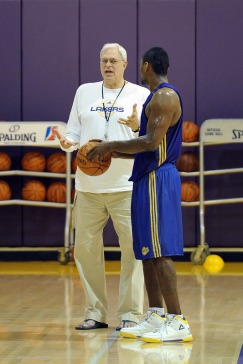 Head Coach Phil Jackson and Ron Artest  of the Los Angeles Lakers talk after the Lakers practice on November 16, 2009 at Toyota Sports Center in El Segundo, California.    picture appears courtesy  of nbae/getty images/ Noah Graham ...............