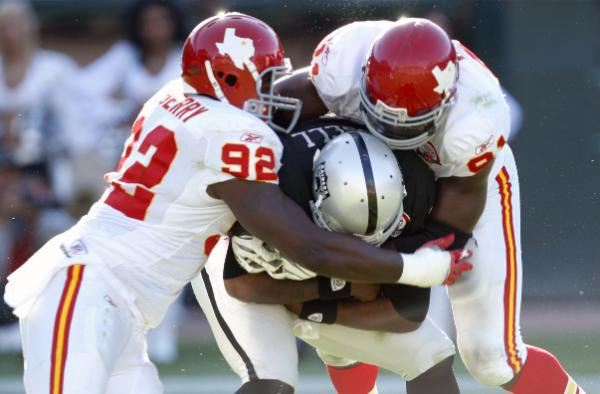 Raiders' quarterback  JaMarcus  Russell  center  is  sacked by  Chiefs' defensive  ends   Wallace Gilberry and  Tamba   Hali in  the  second  quarter  of the  game Raiders' quarterback  JaMarcus  Russell  center  is  sacked by Chiefs' defensive  ends   Wallace Gilberry and  Tamba   Hali in  the  second  quarter  of the  game played at  the  Oakland Alameda  County Coliseum,Oakland ,California. The  Kansas City Chiefs would go on to  defeat the Oakland  Raiders 16-10. picture  appears courtesy of  ap/photo/ Ben Margot ........