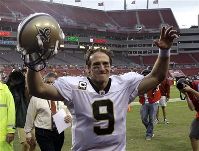 New Orleans Saints quarterback Drew Brees waves his arms to fans as he leaves the field after defeating the Tampa Bay Buccaneers 38-7 in an NFL football game in Tampa, Fla., Sunday, Nov. 22, 2009. picture appears courtesy of ap/photo/ John  Raoux  .................