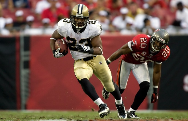 Running back Pierre Thomas (23) of the New Orleans Saints runs the ball against the Tampa Bay Buccaneers during the game at Raymond James Stadium on November 22, 2009 in Tampa, Florida.  picture appears courtesy of getty images/ J Meric ......