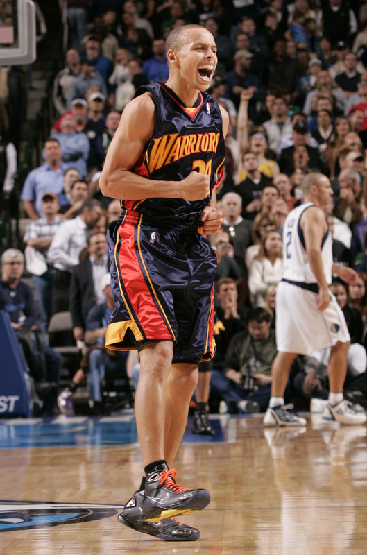 Stephen Curry (30) of the Golden State Warriors celebrates a win against the Dallas Mavericks during a game at the American Airlines Center on November 24, 2009 in Dallas, Texas. picture appears  courtesy of NBAE/Getty Images/  Glenn James .......