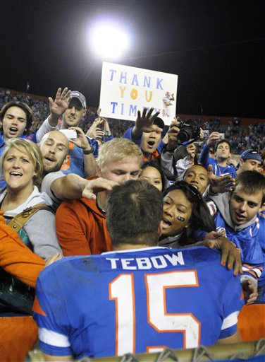 Florida quarterback Tim Tebow is swarmed by fans after an NCAA college football game against Florida State in Gainesville, Fla., Saturday, Nov. 28, 2009.  Florida won 37-10. picture appears  courtesy  of AP/Photo/ Phelan M Ebenhack ..........
