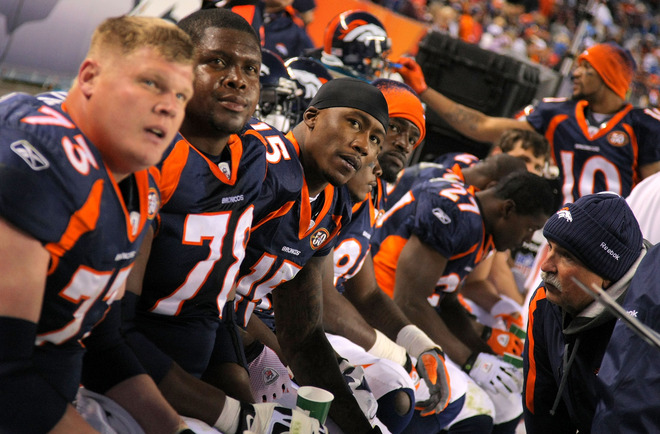 Denver- November 22nd ,2009. (L-R) Chris Kuper (73), Ryan Clady (78), Brandon Marshall (15), David Graham (89), Knowshon Moreno (27), Jabar Gaffney (10) and the Denver Broncos offense look on from the bench as they face the San Diego Chargers during NFL action at Invesco Field at Mile High on November 22, 2009 in Denver, Colorado. The Chargers defeated the Broncos 32-3.  picture appears courtesy of  Getty Images/ Doug Pensinger  ............