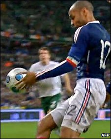 Thierry  Henry  of  France seen  here  with  the  intentional  hand ball  act  that   would   lead  to  the  game tying  goal  scored  by  teammate,  William  Gallas.   picture  appears  courtesy  of  afp/   Paul  Wilkinson   ...............
