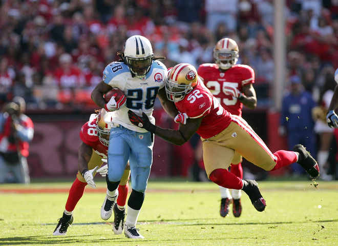 Titans'  running  back   Chris Johnson  (28) is  tackled  by the  San  Francisco  49ers'  defensive  player  Patrick   Willis  (52)   during  the   game  played   at   Candlestick  Park  ,  San  Francisco  ,  California.